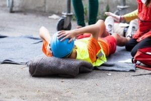 Employee receiving first aid after a workplace accident