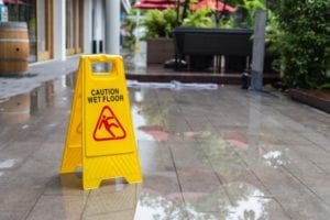 Yellow wet floor sign on the floor in a hotel