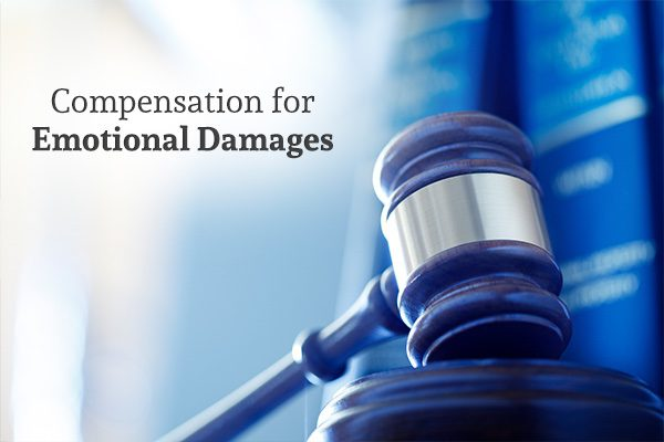 A close up of a gavel with the words, compensation for emotional damages.