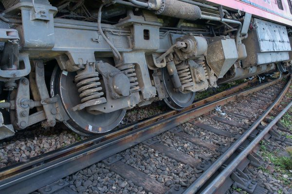 A train has derailed on a track.