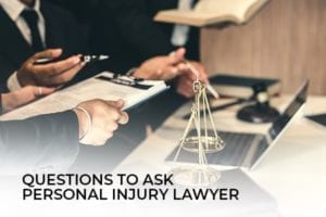 a picture of a lawyer talking to another lawyer with the words, questions to ask personal injury lawyer.