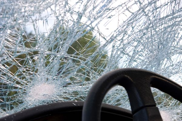 A cracked windshield after a car accident.