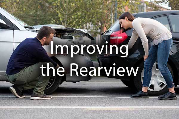 "A rear-end accident with the words, ""improving the rearview."""