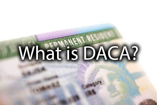 "A green card with the words, ""What Is DACA?"""