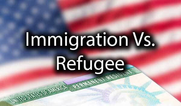 "An American Flag and an card with the words, ""immigration vs. refugee."""