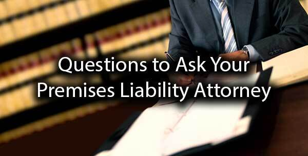 "An attorney going over paperwork with the words ""questions to ask your premises liability attorney."""