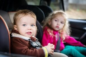 Two children in car seats.