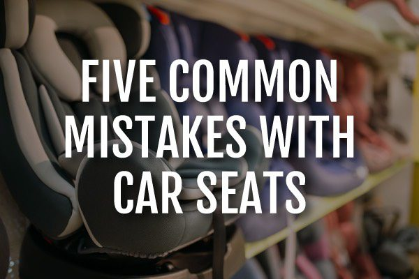 """A picture of car seats at a store with the words, """"five common mistakes with car seats."""""""