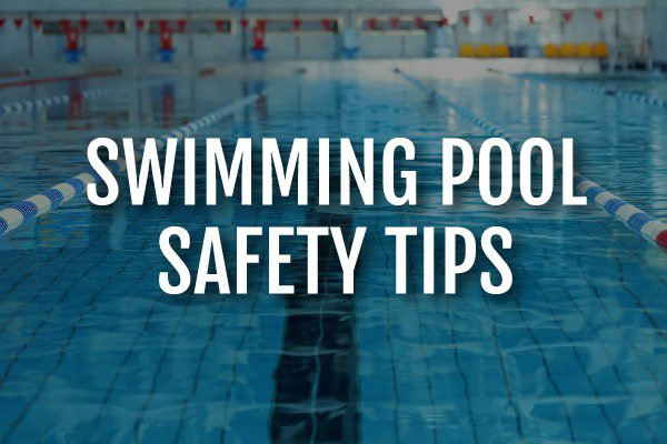 """A lap pool with the words, """"swimming pool safety tips."""""""