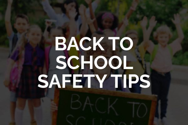 """A bunch of kids going back to school with the words, """"back to school safety tips."""""""