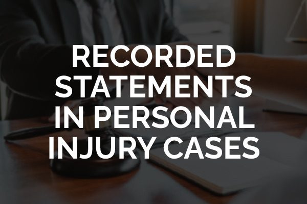 """A lawyer sitting down talking and the words, """"recorded statements in personal injury cases."""""""