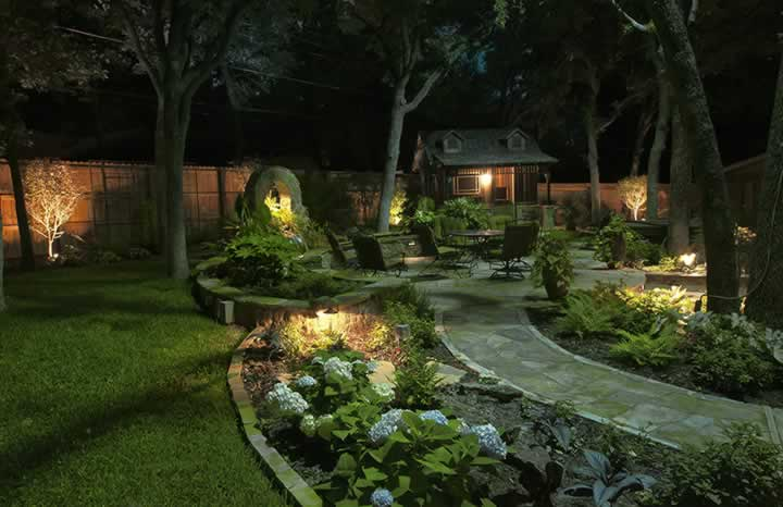 Landscape Lighting illuminates the path leading to a sitting area