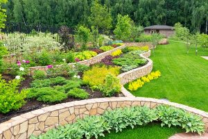 Multi-tiered landscaping featuring a variety of summer plants