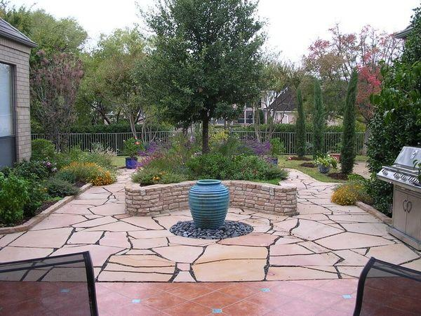 Residential backyard with redesigned landscaping and upgraded patio