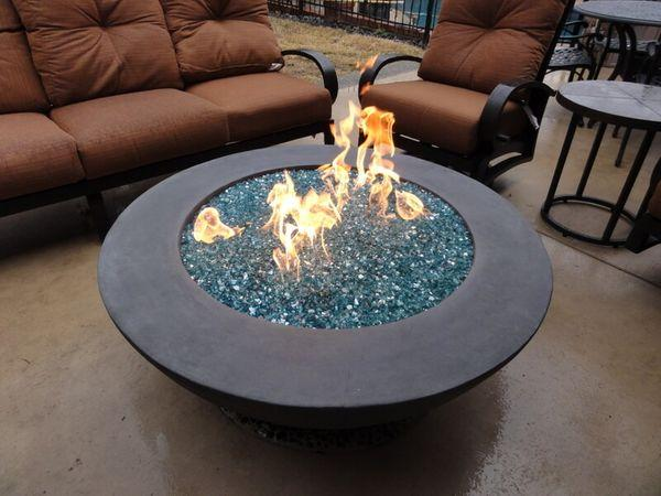 Outdoor fire pit surrounded by patio furniture