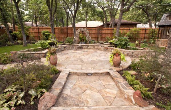 A new backyard patio surrounded by landscaping