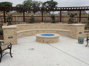custom built fire pit with stone
