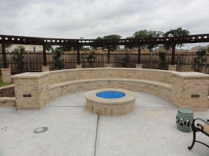 Custom built firepit and seating wall