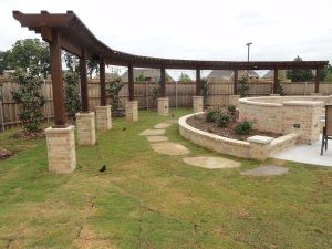 custom made landscaping with stones and pergola