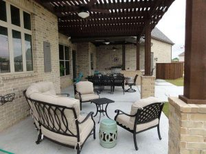 Back patio with kitchen and wooden pergola