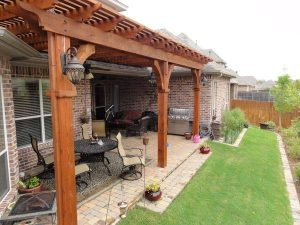 wooden pergola covering outdoor seating