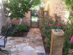 Rod iron gate and stone pathway