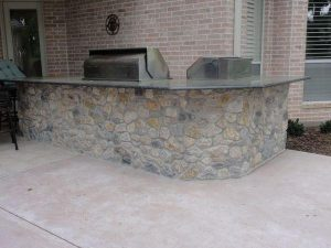 outdoor kitchen made of river rocks