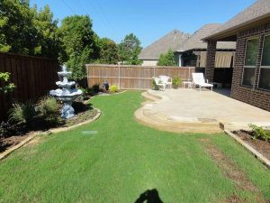 Well maintained backyard with water fountain and back porch