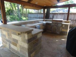 Outdoor kitchen made of stone with grill