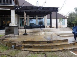 Raised seating area made of stones and a custom fire pit