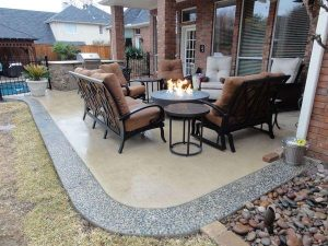 Beautiful back porch seating around a firepit