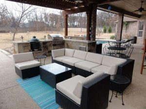 Outdoor seating area with a stone built kitchen