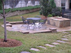 Stone seating area with fire pit