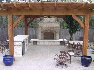 Pergola covering a custom fireplace and seating area
