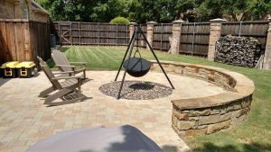 Stone seating area with stone retaining wall