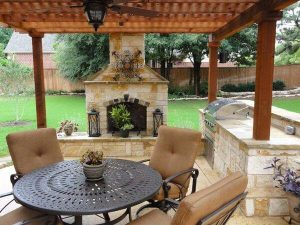 Outdoor kitchen covered by a pergola