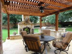Wooden pergola with fire place and outdoor kitchen