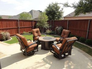 backyard seating area with new landscaping surrounding