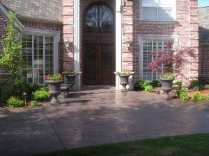 Stone entrance with standing flower pots