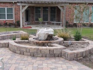 Stone landscaping with rock water fountain