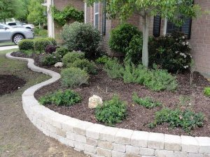 New landscaping with stone wall