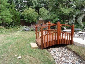 cute wooden bridge over a rock creek bed