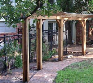 small wooden pergolas covering brick walkway
