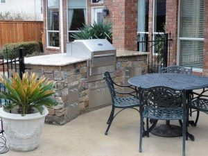 Backyard kitchen with grill
