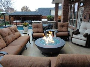backyard seating area around a fire pit