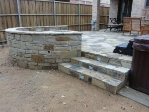 stone steps. and round retaining wall around a fire pit