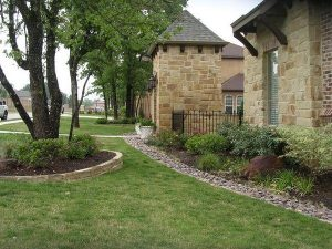 new landscaping in front of a beautiful stone home