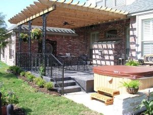 Wooden pergola held up by iron beams