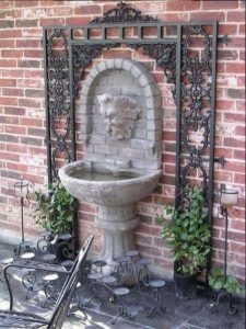 Water fountain with iron panels