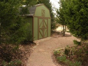 green wooden shed